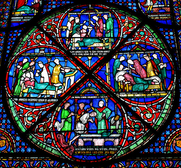 Stained glass window with scenes of healing